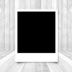 Blank photo frame on big White wood plank floor texture backgrou