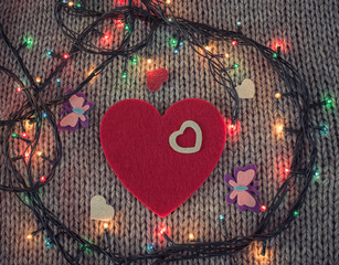 Red felt heart with colorful butterflies, colorful garland with