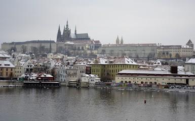Prague castle with snow and grey sky