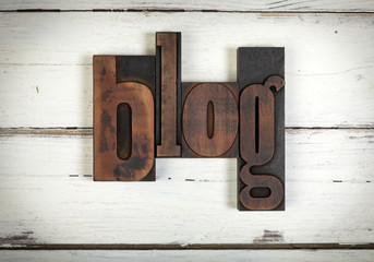 blog, written with old wooden letters. word blog, written with vintage letterpress type on white wooden background
