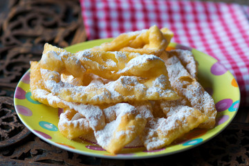 Flancat- crisp deep fried pastry dusted with powdered sugar.