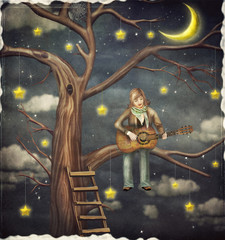 The boy sits on tree and plays  on   guitar