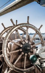 Steering wheel of an old sailing vessel, close up