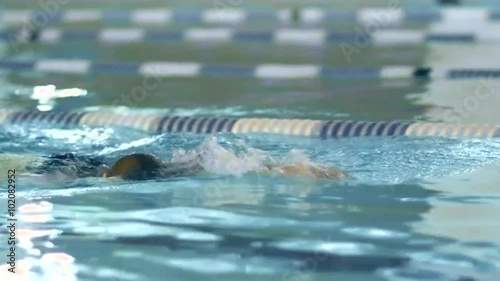 Close-up shot of Professional Female Swimmer Performing