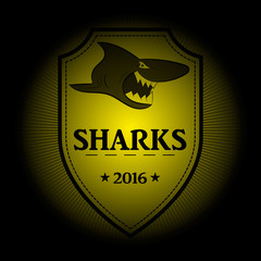 Sharks! Sports logo. the emblem appearing out of the darkness. Perfect on your black shirt! vector