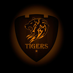 Tiger a sports logo. the emblem appearing out of the darkness. Perfect on your black shirt! vector