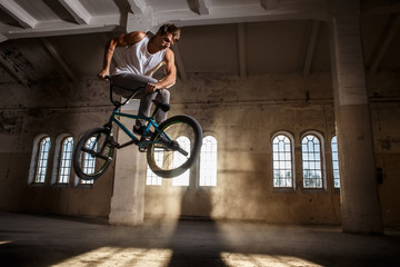 A man jumps with bmx.