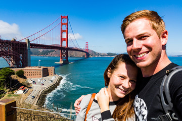 Couple in front of the Golden Gate Bridge, San Francisco