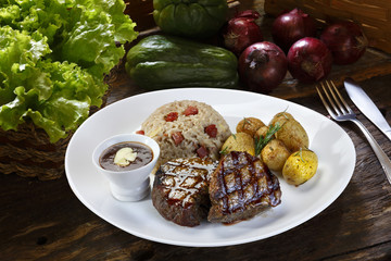 Grilled steak with potato and rice