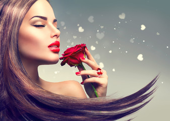 Wall Mural - Beauty fashion model woman with red rose flower