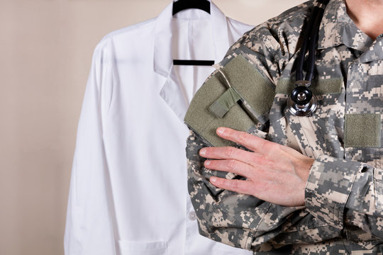 Medical military doctor with medical jacket in background