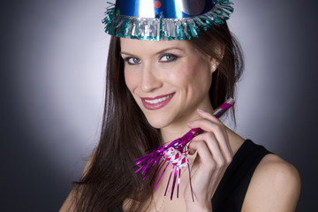 Pretty Woman Celebrates With Party Favors Hat Noise Maker