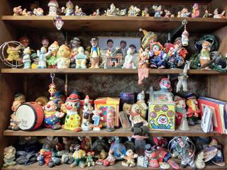 Shelves full of creepy clown toys - landscape photo