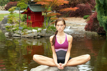 Sensual Yoga Woman Meditating on Rock
