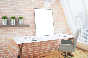 Blank white poster on white wooden table in loft room with brick