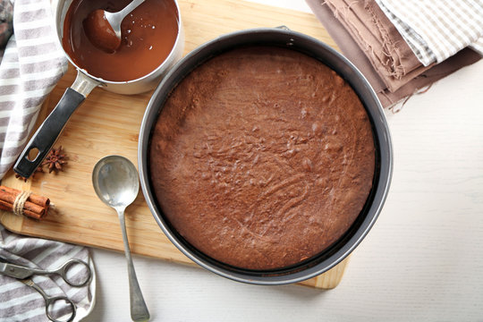 Tasty chocolate cake in baking pan on a table