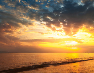 Stunning beautiful sunset. The sun falls into the sea