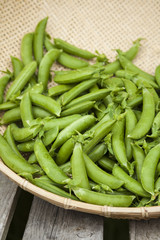 Organic snap peas in basket at farmers market