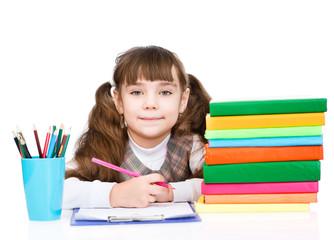 young schoolgirl doing homework. isolated on white background
