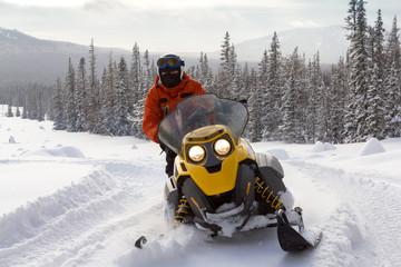 Athlete on  snowmobile