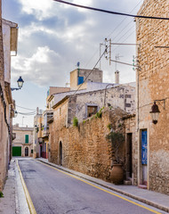 Wall Mural - View of a old rustic village street