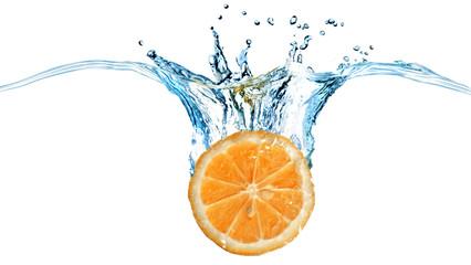 Fresh orange dropped into water with splash