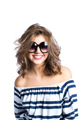 Smiling woman in sunglasses.