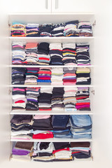 Dressing White Closet with Clothes Arranged Neatly Thickly Order