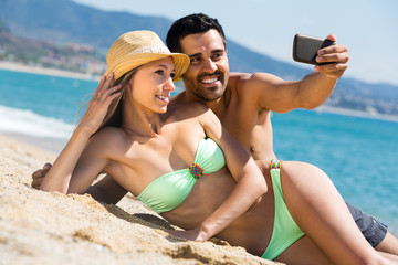Couple making a selfie on beach