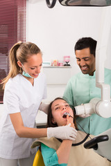 Dentist examines patient at clinic