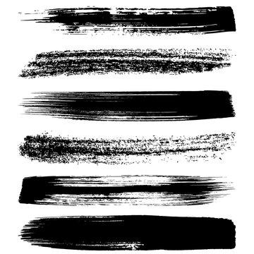 Black brush strokes silhouettes