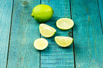 Ripe lime fruit on wooden vintage background. Healthy vegetarian food. Recipe, menu, mock up, cooking.