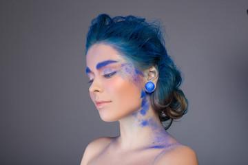 Blue make up. Studio shot. Creative idea