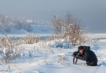 photographer taking photo on the snow