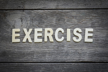The word exercise on the wooden floor