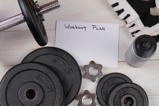 Fitness background. Workout plan, dumbbells. Copy space image