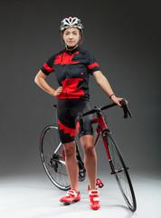 woman cyclist on a road bike in studio