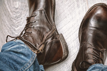 boots and jeans on men's feet close up