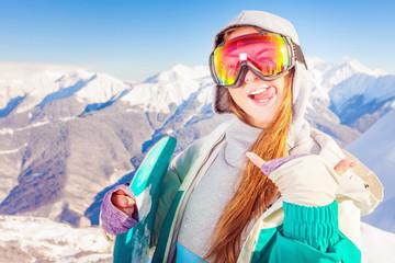 Snowboard. Sport woman in snowy mountains