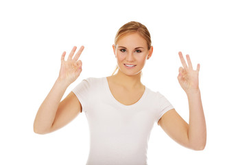 Young woman showing two OK signs