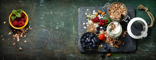 Healthy breakfast of muesli, berries with yogurt and seeds Wall mural