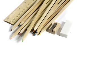 pencil, eraser, sharpener, wood meter on white background