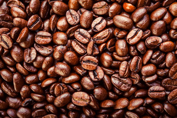 Roasted coffee beans. Background, macro. Top view