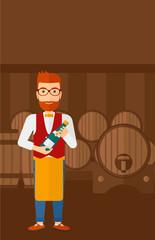 Waiter holding bottle of wine.