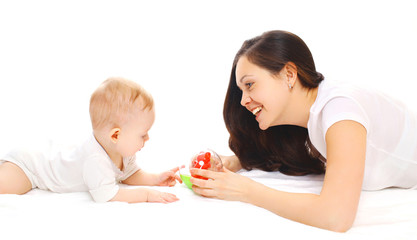Happy smiling mother and baby playing in toys over white backgro