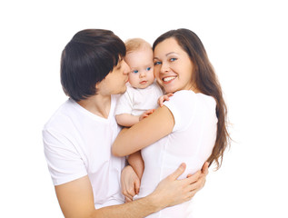 Happy young family, mother and father kissing baby on a white ba