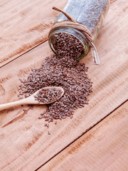 Alternative health care and dieting flax seeds in wooden spoon s