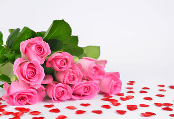 Bouquet of pink roses with a heart. Valentines day background.