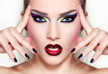 A girl with bright makeup. Red lipstick.