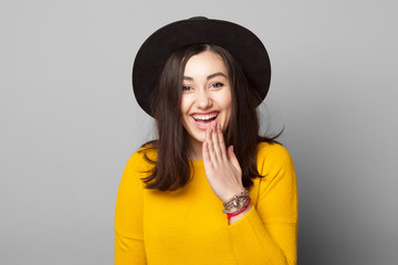 young woman with shy mistake gesture